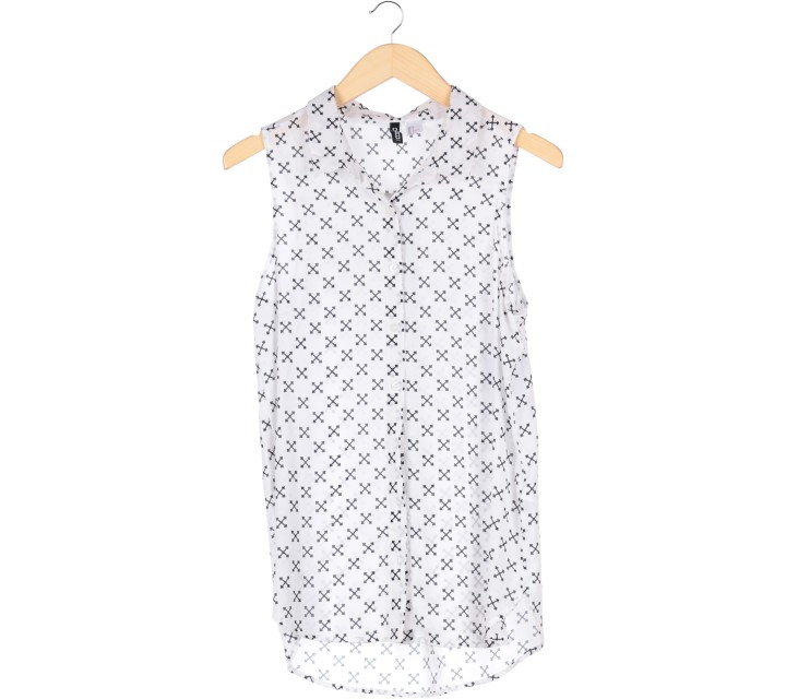 Divided Black And White Sleeveless Blouse