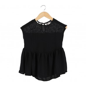 This is April Black Lace Sleeveless