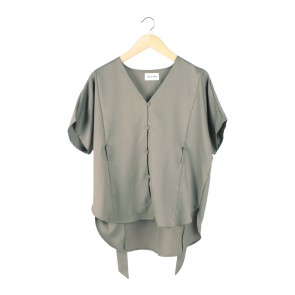 This is April Brown Tied Blouse